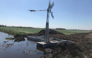 Hoogwaterboerderij windmolen